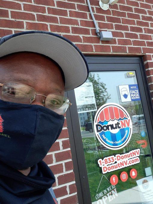 Dele at The front door of Donut NV in Pottstown